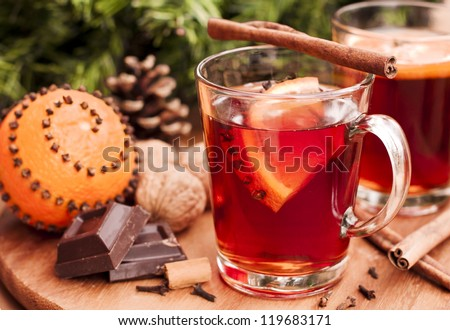 Hot wine and oranges in traditional Christmas arrangement - stock photo