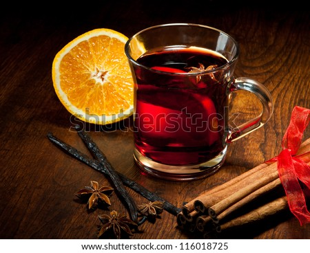 Hot wine for winter and Christmas with delicious orange and spices - stock photo
