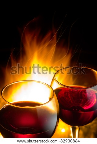 hot wine night, against the backdrop of a burning fire - stock photo