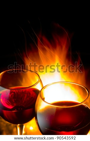 hot wine winter night, against the backdrop of a burning fire - stock photo
