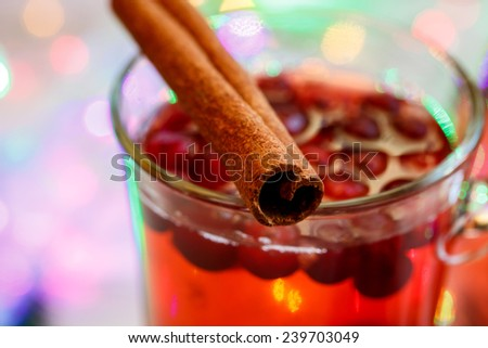 Hot winter drink with cranberries. - stock photo