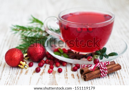 Hot winter drink with cranberries and cinnamon - stock photo