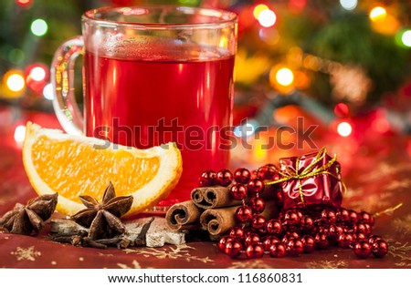 Hot winter drink with spices and orange.