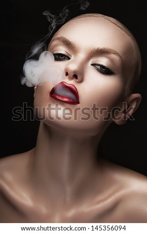 hot woman with smoke in mouth