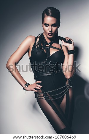 hot woman with whip around neck - stock photo