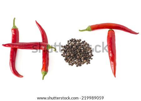 Hot word made from red hot chili pepper and peppercorn on white background - stock photo