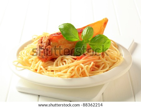 Hot yellow pepper stuffed with minced meat served with spaghetti