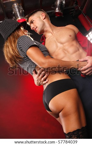Hot young couple's passion at the nightclub - stock photo