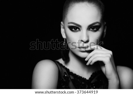 Hot young woman model with sexy lips makeup, strong eyebrows, clean shiny skin. Beautiful fashion portrait of glamour female face. Black and white photo