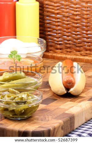 hotdog ingredients on a nice table setting rich in colors and flavors perfect for picknicks - stock photo