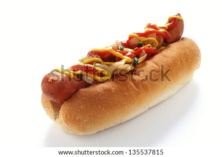 Hotdog with mustard and ketchup and onions isolated
