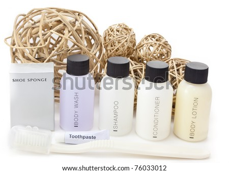 Hotel amenities kit with decorative wicker balls. - stock photo