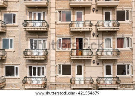 Hotel apartment balcony texture pattern. Detail of the facade of a apartment building, outdoor view of rows of balconies / terrace