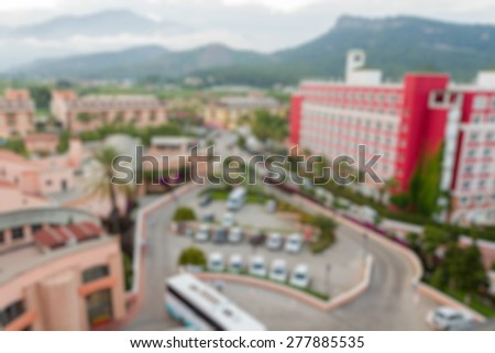 hotel area buildings view with montains abstract blur background