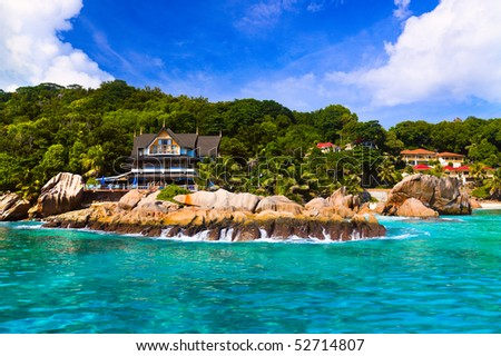 Hotel at tropical beach, La Digue, Seychelles - vacation background - stock photo