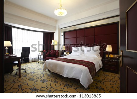 Hotel bedroom - stock photo