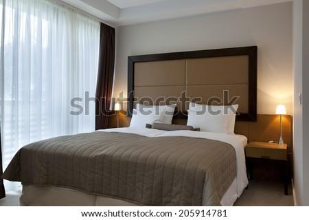 Hotel bedroom in the morning  - stock photo