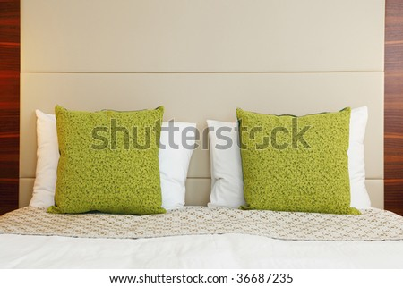 hotel bedroom with green pillow - stock photo
