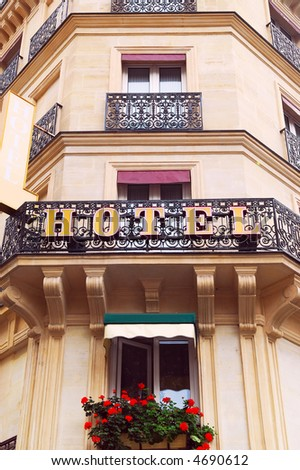 Hotel building with wrought iron balconies in Paris, France - stock photo