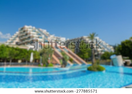 hotel buildings with swimming pool view abstract blur background - stock photo