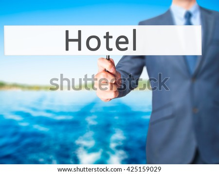 Hotel - Businessman hand holding sign. Business, technology, internet concept. Stock Photo - stock photo