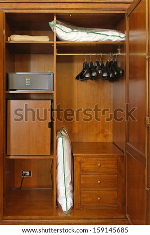 Hotel closet with safety box and small fridge - stock photo