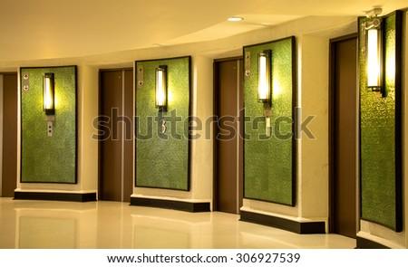 hotel corridor green Elevatorhotel - stock photo