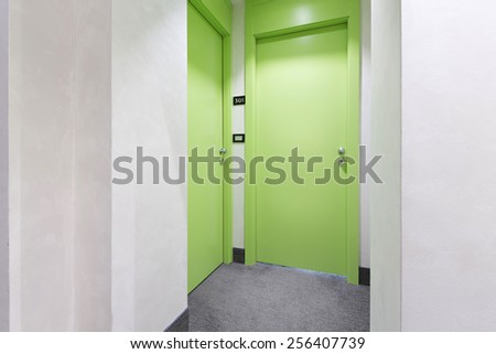 Hotel corridor with doors - stock photo