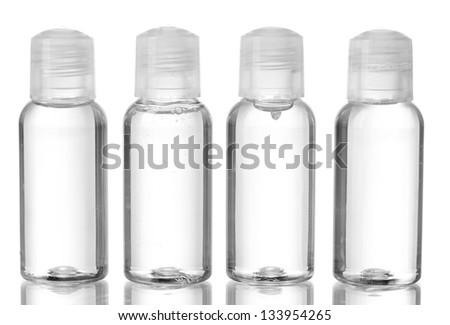 Hotel cosmetic bottles isolated on white - stock photo