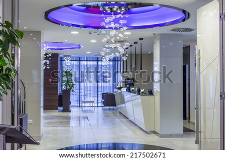 Hotel entrance hall and reception - stock photo