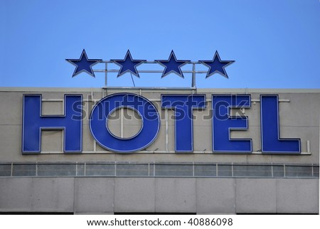 Hotel facade. Word is in blue with neon
