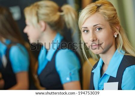 hotel female receptionist or support help desk worker - stock photo