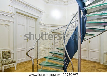 Hotel hallway with a modern staircase - stock photo
