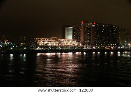 Hotel in Jacksonville, Florida, with St. John's River, EOS Digital Rebel, ISO 1600, 1/4 sec, F 8.0 - stock photo