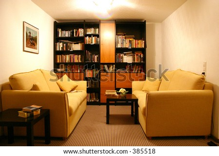 hotel library with two sofas and shelf full of books