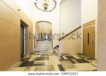 Hotel lobby interior with elevator and stairs - stock photo