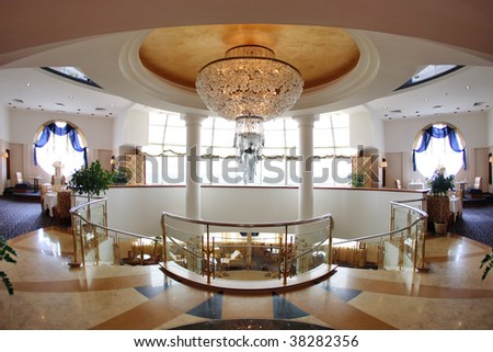 Hotel lobby with great round chandelier - stock photo