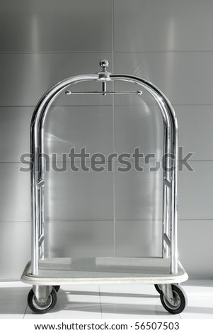 hotel luxury trolley barrow silver chrome gray background - stock photo