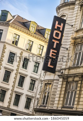 hotel neon sign in European capital city - stock photo
