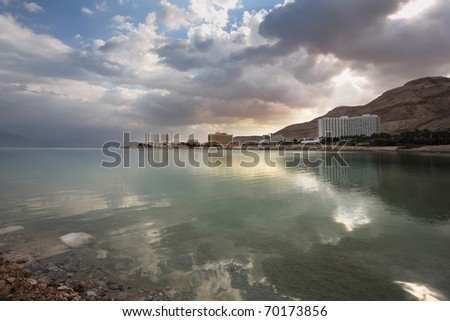 Hotel on the shores of the Dead Sea in Israel. Incredible lighting effects.. Sunset. - stock photo