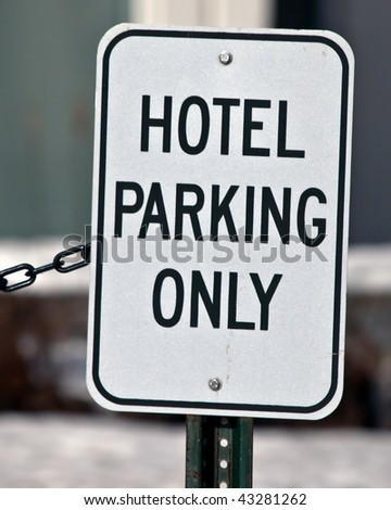 Hotel Parking Only sign in front of building