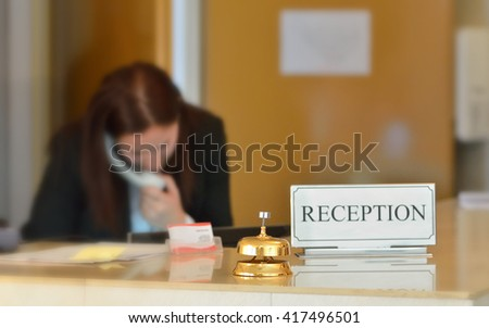 hotel reception counter desk with bell - stock photo