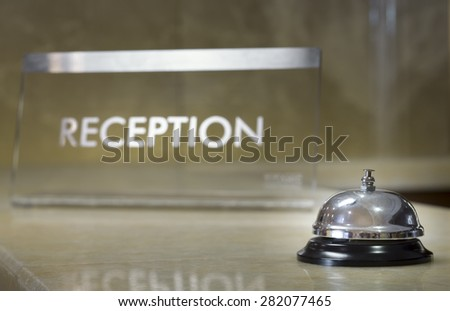 Hotel reception with bell - stock photo