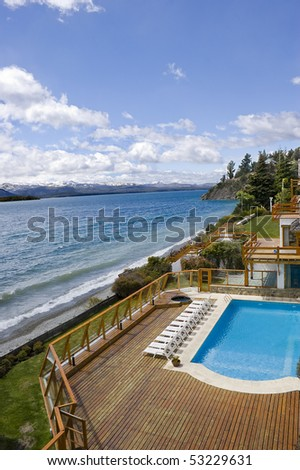 Hotel resort pool by the lake shore. Nahuel Huapi lake. Patagonia. Argentina - stock photo