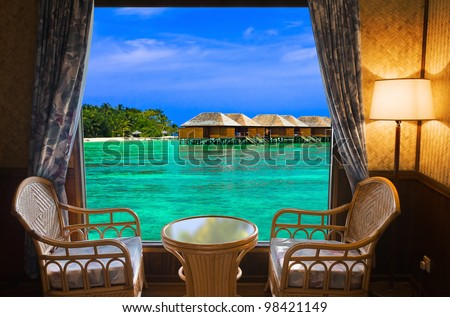 Hotel room and tropical landscape - vacation concept background - stock photo