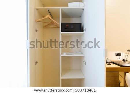 Hotel room interior , closet with safe box