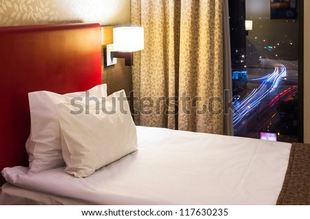 hotel room interior with window at night - stock photo