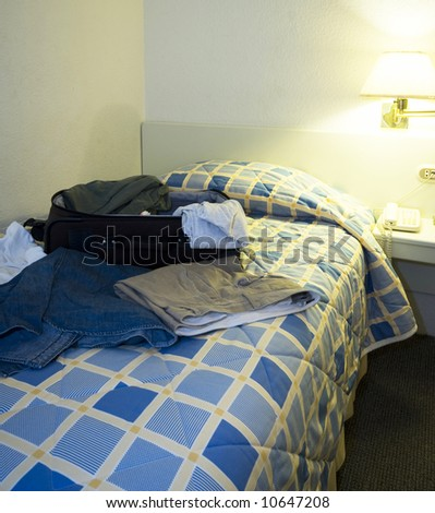 hotel room open suitcase clothes on bed guayaquil ecuador