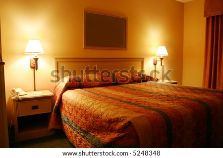 Hotel room - orange glow - fill in your wall art or logo. - stock photo