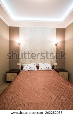 Hotel room. Small bedroom with double bed. Modern interior room. Small bedroom with double bed. Modern interior room - stock photo